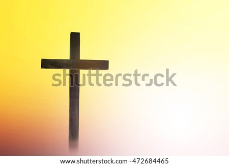 Silhouette the cross over a sunset background. Worship, Forgiveness, Mercy, Humble, Repentance, Reconcile, Adoration, Glorify, Redeemer, Christmas cross, love, sunlight, sacrifice, save, life