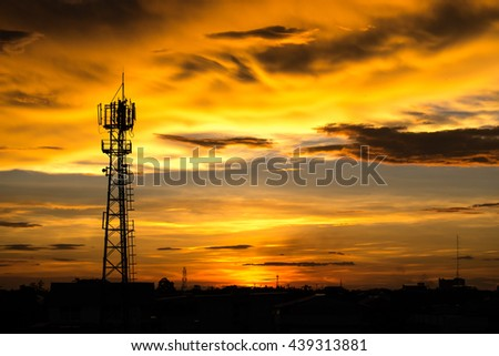 Silhouette the mobile communication antennas in evening sky - stock photo