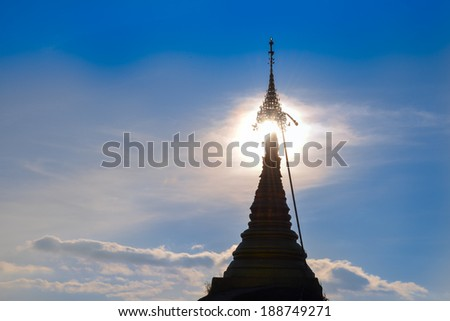 silhouette top of Golden rock, Kyaikhtiyo pagoda, Myanmar   - stock photo