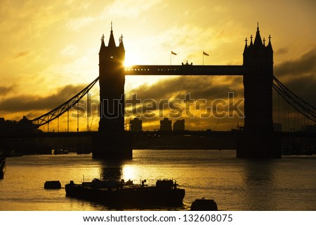 Silhouette Tower Bridge at sunrise, London, UK - stock photo