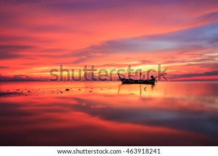 Silhouette traditional longtail boat and beautiful red sky sunset at Samui island southern of Thailand
