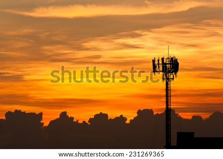 Silhouette view of cellphone antenna under twilight sky - stock photo