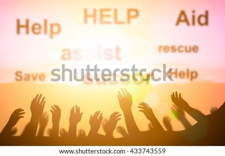 Silhouette volunteer voluntary volunteering aid Assistants concept. volunteer group raising hands against sunset sky background. help and hope concept, waiting helping hand. community concept. - stock photo
