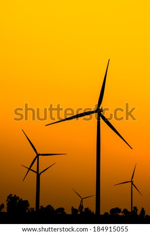 Silhouette wind turbine power with sunset and tree / wind farms Thailand,Nakhon Ratchasima