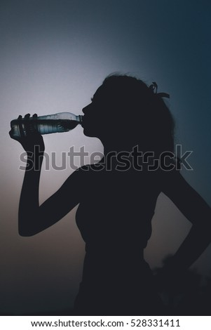 silhouette, woman drinking water