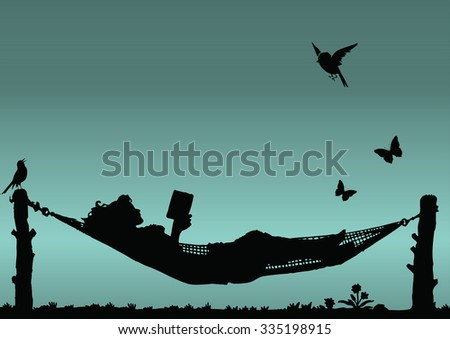 Silhouette woman reading in a hammock - stock photo