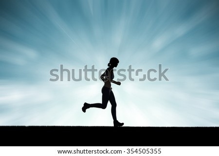 silhouette woman running on blue abstract background