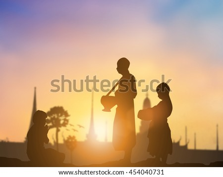 Silhouette woman sitting Buddha representing Buddha in Buddhist holy days. All religions teach people to be good people doing good things over blurred pastel background. Good and People concept. - stock photo