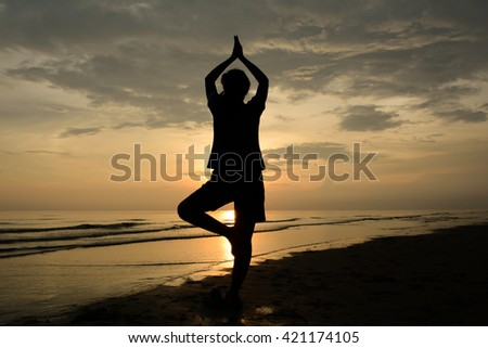 Silhouette Woman Yoga.background sunset over the sea.