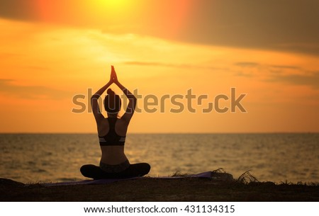 Silhouette Woman Yoga - relax in nature durig sunset