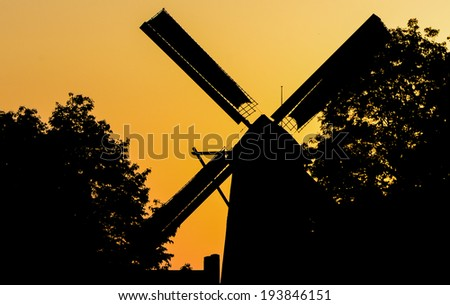 Silhouette wooden windmill in the Netherlands - stock photo