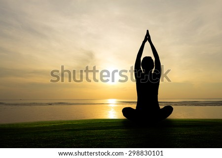 silhouette yoga practicing at sunset, meditation