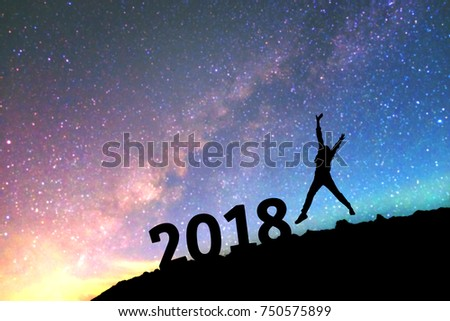 Silhouette young man Happy for 2018 new year background on  the Milky Way galaxy pointing on a bright star. dark sky tone . Vintage grain tone.