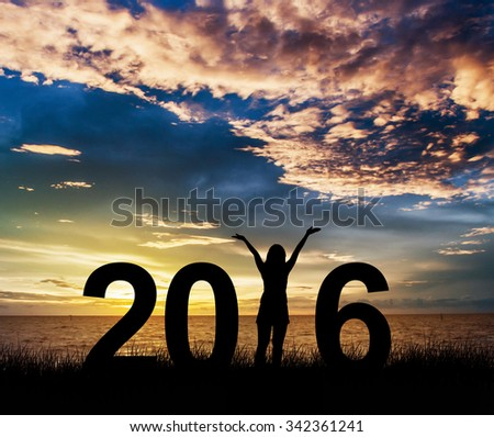 Silhouette young woman Enjoying on the hill and 2016 years while celebrating new year - stock photo