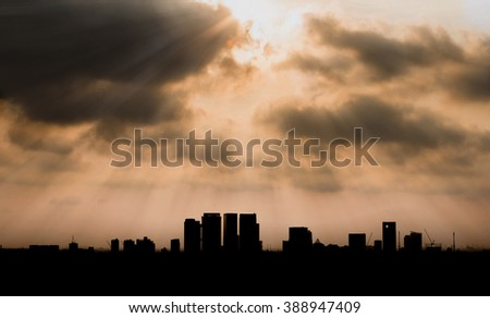 Silhouetted Bangkok city (Thailand) with sun ray in the morning