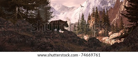 Silhouetted grizzly bear overlooking a rocky mountain canyon with soaring falcon. - stock photo