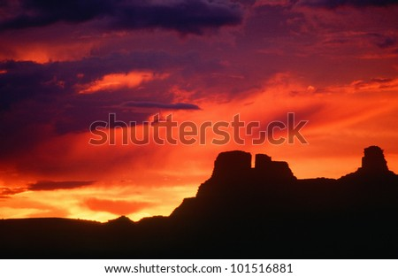 Silhouetted Indian ruins, Chaco Canyon at sunset, New Mexico - stock photo