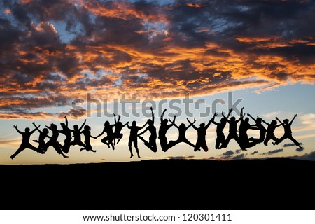 silhouetted large group of teens jumping in sunset
