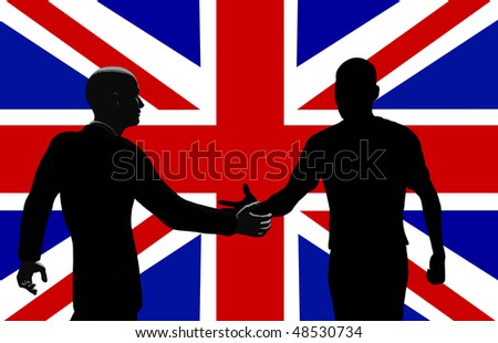 Silhouetted men shaking hands .