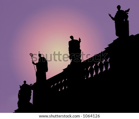 Silhouetted statues on top of the Dresden cathedral