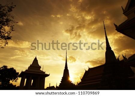 Silhouetted stupas at Wat Arun - stock photo