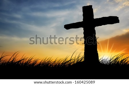 Silhouettes Cross and sunset sky - stock photo
