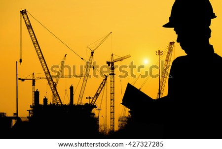 Silhouettes man of workers on a background of Construction  - stock photo