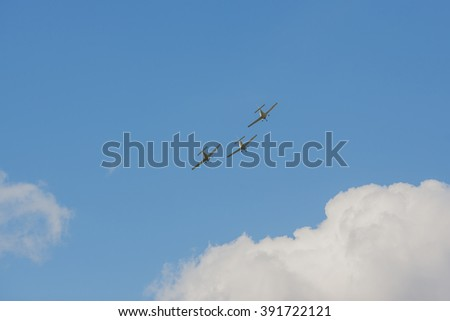 Silhouettes of aircrafts in the sky - stock photo
