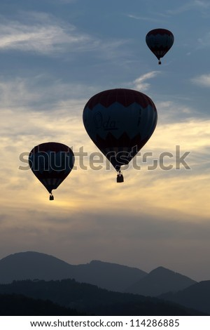 Silhouettes of balloons in the late evening - stock photo