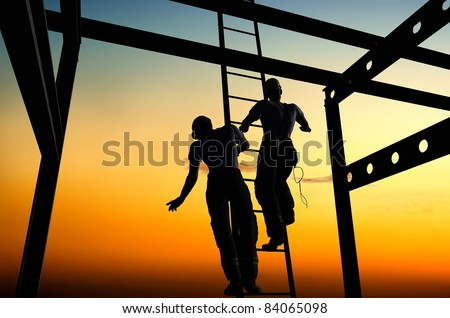 Silhouettes of business on the stairs.