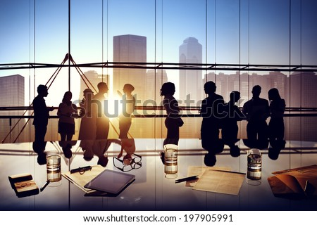 Silhouettes of Business People Brainstorming Inside the Office - stock photo