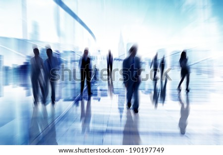 Silhouettes of Business People in Blurred Motion Walking - stock photo