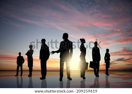 Silhouettes of business people standing in line