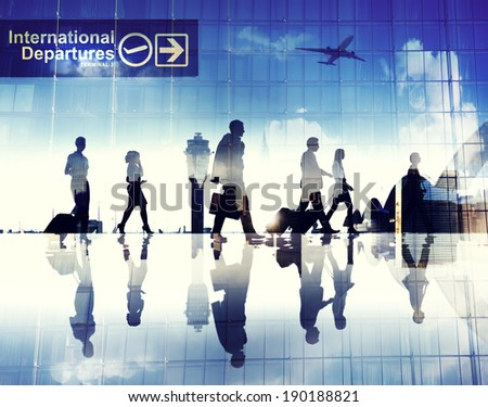 Silhouettes of Business People Walking in an Airport - stock photo
