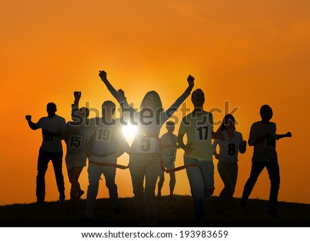 Silhouettes of Business People Winning Concept - stock photo