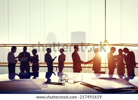 Silhouettes of Business People Working - stock photo