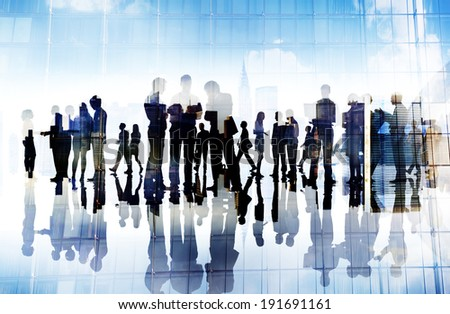 Silhouettes of Business People Working in an Office - stock photo