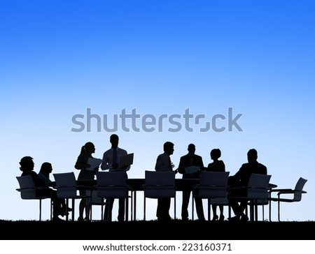 Silhouettes of Business People Working Outdoors