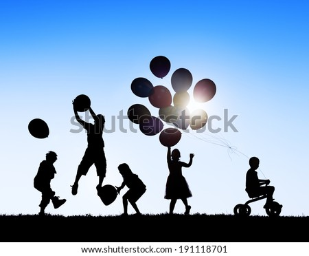 Silhouettes of Children Playing Balloons and Riding Bicycle - stock photo