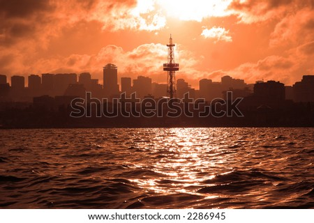 Silhouettes of city during sunset - Baku, Azerbaijan - stock photo
