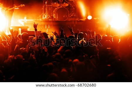silhouettes of concert crowd - stock photo