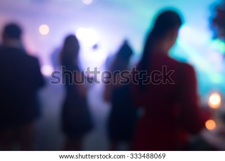 silhouettes of concert crowd in front of bright stage lights - stock photo
