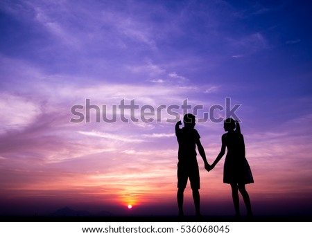 Silhouettes of  couple man and woman talking in sunset