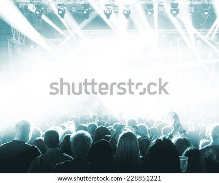 Silhouettes of crowd at a rock concert - stock photo