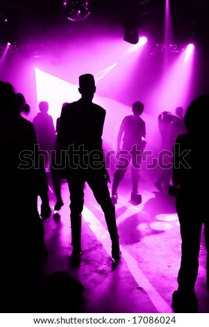 silhouettes of dancing people in a disco