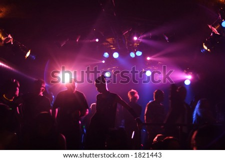 silhouettes of dancing people in an underground club - stock photo