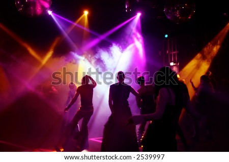 Silhouettes of dancing teenagers - stock photo