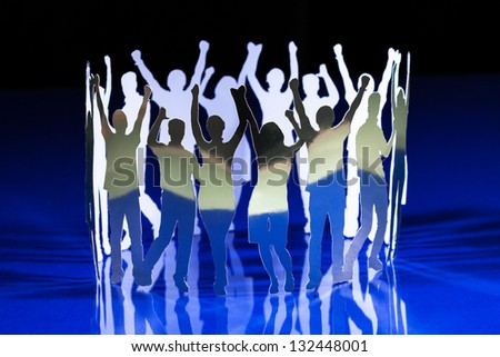Silhouettes of exited people standing in circle - stock photo