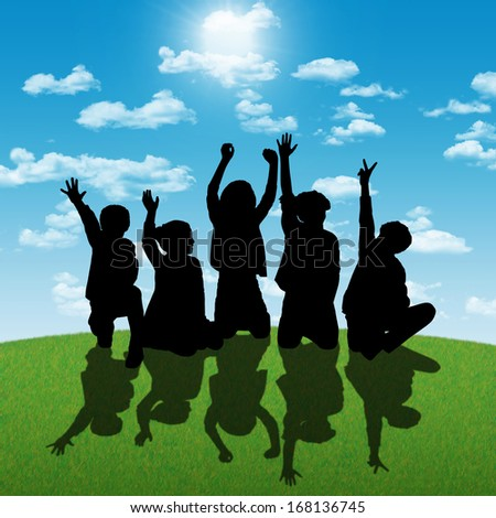 silhouettes of five children about age 7-10 seated in a row on the grass back to the shining sun, their hands are in the air - stock photo
