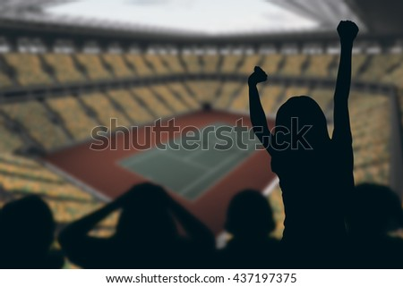 Silhouettes of football supporters against tennis field on a stadium - stock photo
